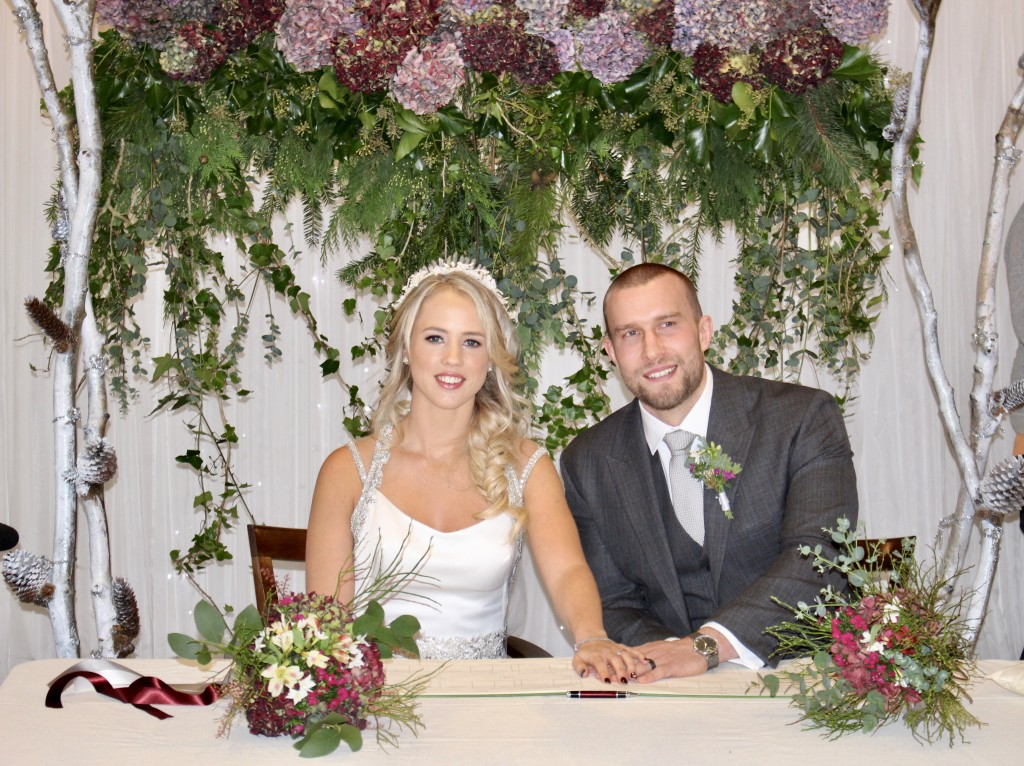 wedding flower hanging ivy hydrangeas bride groom signing register picture