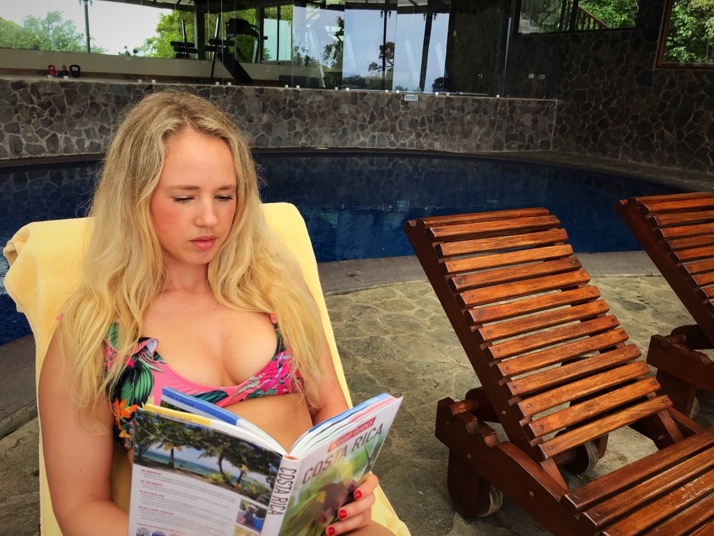 costa rica trip planning by the pool hotel